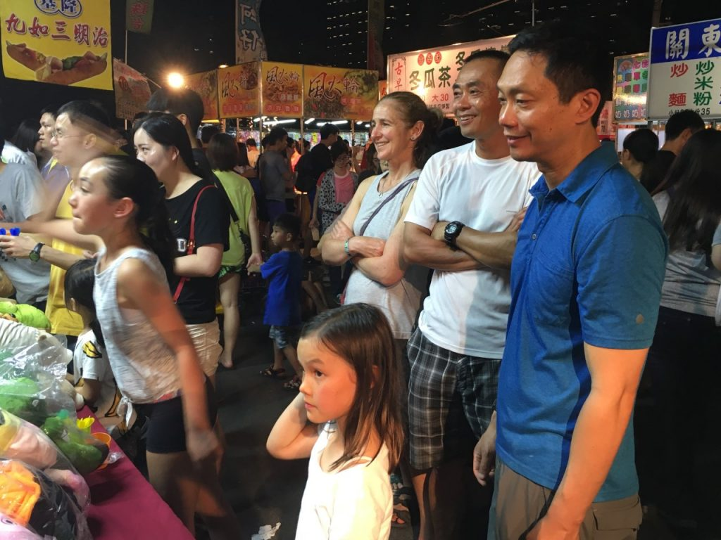 Dr. George Yang and his family at a market for Taiwanese Night.